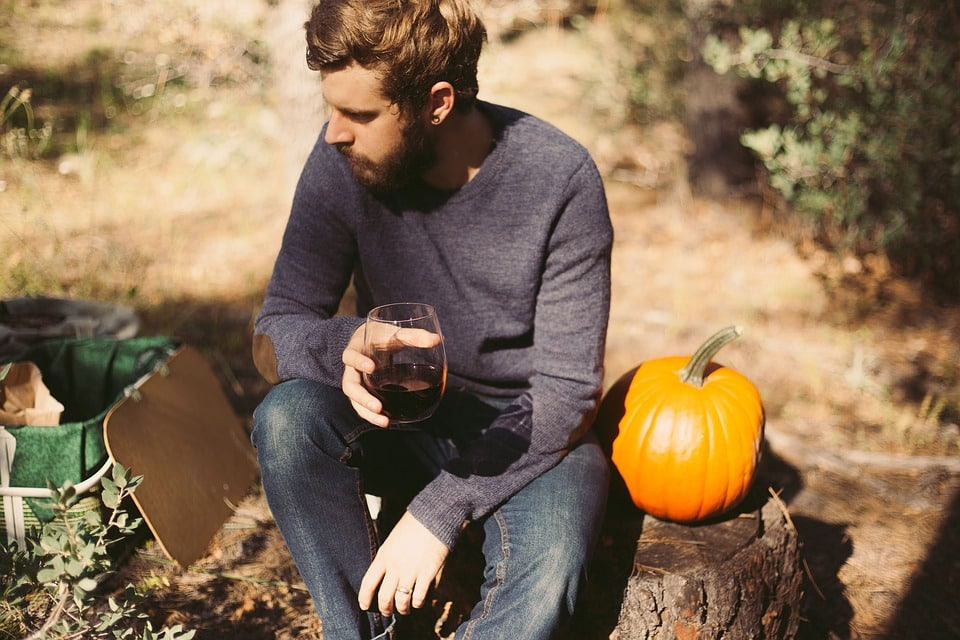 Man in Sweater Drinking Wine